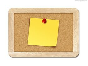 Blank note pinned to corkboard
