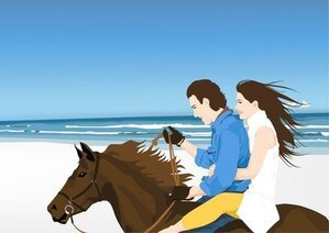 Horse Riders On Beach