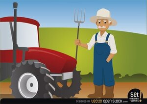 Farmer with Pitchfork Beside His Tractor