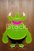 Balloon lip character on wood background