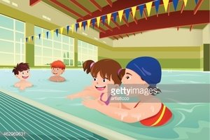 Kids having a swimming lesson in indoor pool
