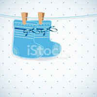 Baby boy shower card. Knitted socks on light background.