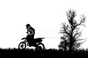 Vector silhouette of  man on a motorcycle.