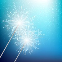Sparkler on blue Christmas background