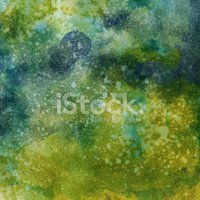Earthy green textured watercolor with paint splatters