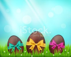 Vector  chocolate easter eggs  on green  background with in gras