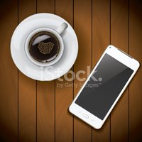 Smartphone mockup template with coffee cup on wood background