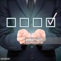 businessman holding checklist symbol