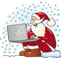Santa Claus with laptop computer