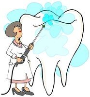 Female dentist cleaning a tooth
