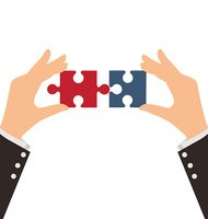 Two Business Hands combining two pieces of puzzle, Teamwork Concept