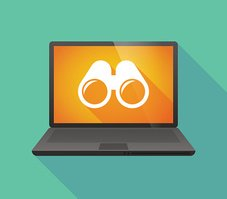 Laptop icon with a binoculars